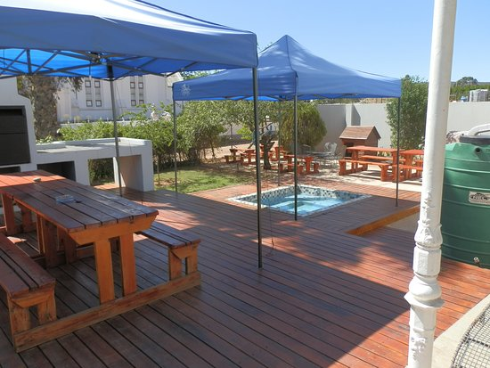 Outside braai, deck, pool and view