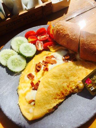 Egg omelette bacon/cheese with freshly baked ciabatta.