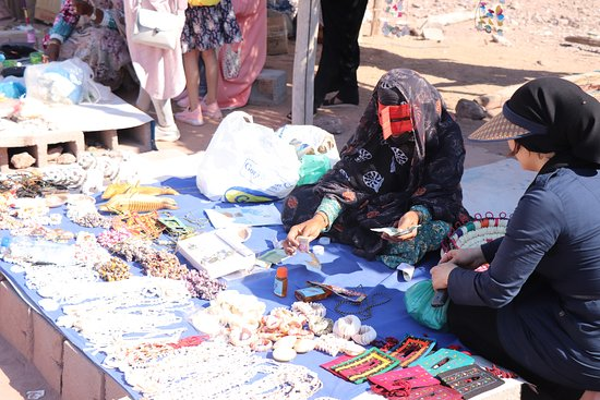 Hormoz, Iran: traditional bazars of Iran in south of Iran is like this. the salespersons are all women and they use such things for covering their faces. it has two reason. not seen by men and not burned by sun