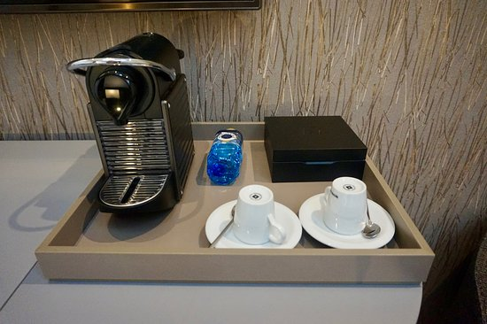 AC Hotel Recoletos: Close up of the in-room coffee service, restocked daily including bottled water
