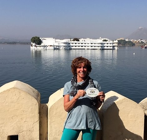 I travel with my Tripadvisor (car magnet) In front of where one fo the James Bond movies, Octopussy,was filmed, now the Taj Lake Palace