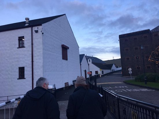Giant's Causeway Premium Day Tour from Belfast (Includes Admissions): Brian (our town guide) leading us into Old Bushmills Distillery