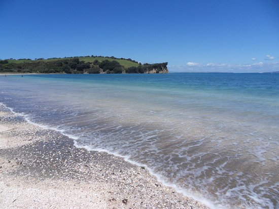 Long and wide curving beach with safe and easy swimming access