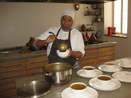 Mouna dishing out the harira soup we made, L'Atelier Madada Moroccan Cooking Workshop, Essaouira, Morocco