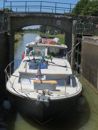 Canal du Nivernais: Four days afloat on our cabin cruiser; comfortable, friendly and easy to handle. Entering into a lock on the canal between Decize and Cercy-La-Tour.