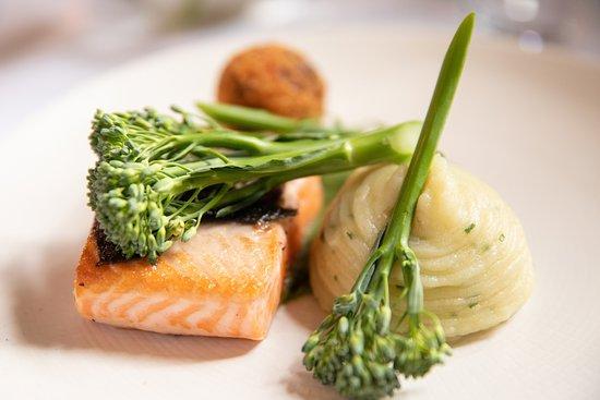 The Green Room Restaurant: Fillet of Salmon - salmon belly bon bon, chive mashed potatos, garden herbs, tender stem broccolli, sundried tomato veloute