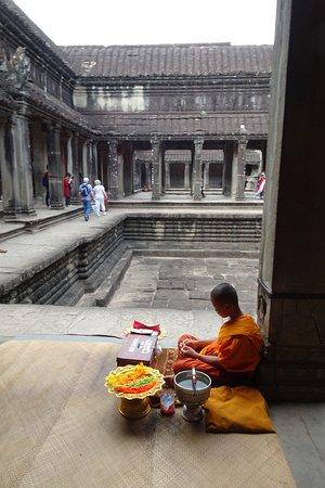 inner courtyard with Buddhist monk (seeking donations)