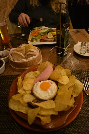 Steak , egg and chips , Portuguese style , with tuna steak in the background