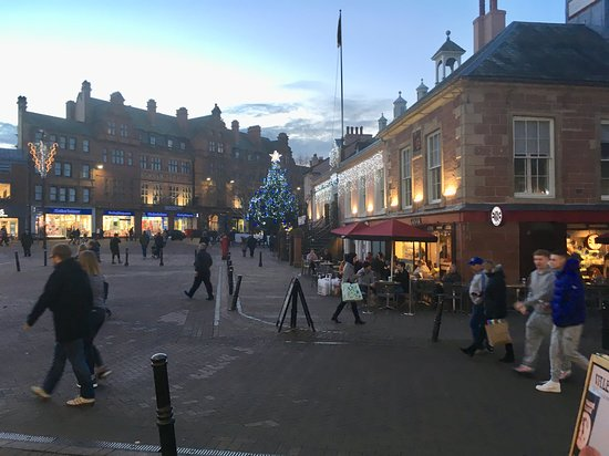 Carlisle, UK: Early Evening shoppers, in City Centre, late November