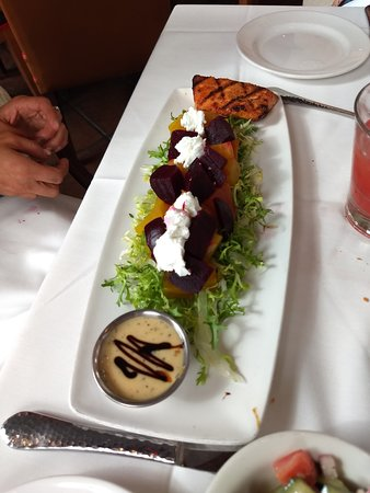 The elegantly presented beet salad with salmon