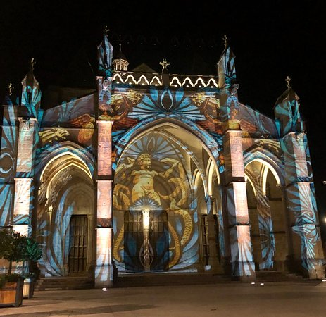 A second view of the lighted facade of the Notre Dame Basilica
