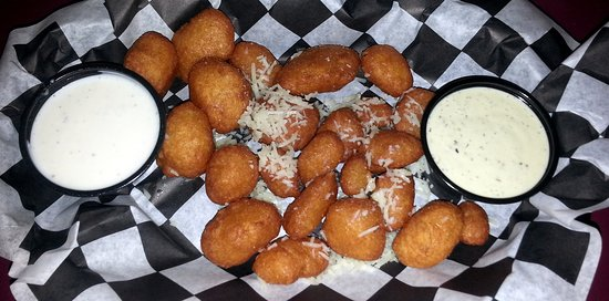 cheese curds with ranch dipping sauce and a jalapeno dipping sauce