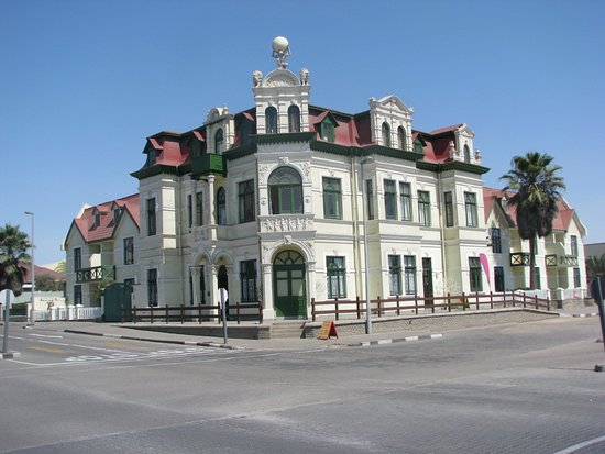 "We offer city tours of Swakopmund which has many histrical buildings dating from the German colonial past. One of the most prominent historical building of that era is the ""Hohenzollern"" building seen on this picture. It was built in 1905 as a hotel and housed the first town council of Swakopmund. It has been changed to sectional title flats in the meantime and is well preserved."