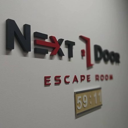 ‪Next Door Escape Room‬