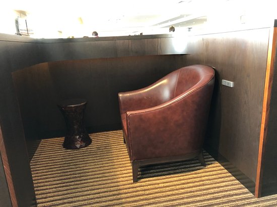 Japan Airlines (JAL): Private seating cubicle with armchair and pedestal table