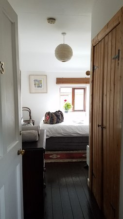 Bastion B&B: The room is very bright in the day for having a single window, likely because the room isn't overly large and the white walls. It feels airy.