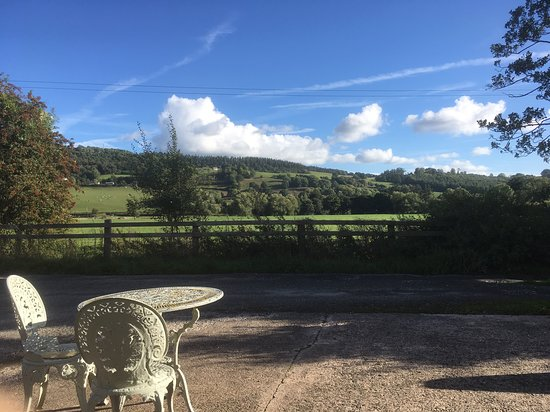 Meifod, UK: View from the front of the cottage with seating outside to take in the scenery