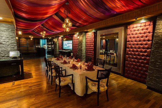 Rivaaj: Lush drapery and ornate auburn wall decor adds mystery and charm to the restaurant's ambiance