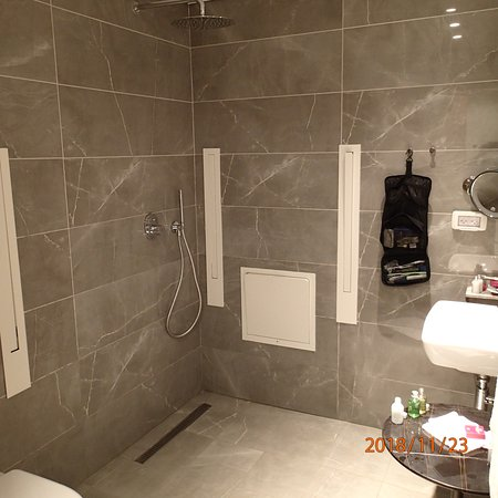 Who designed a bathroom like this? if you take a shower, everything gets wet.