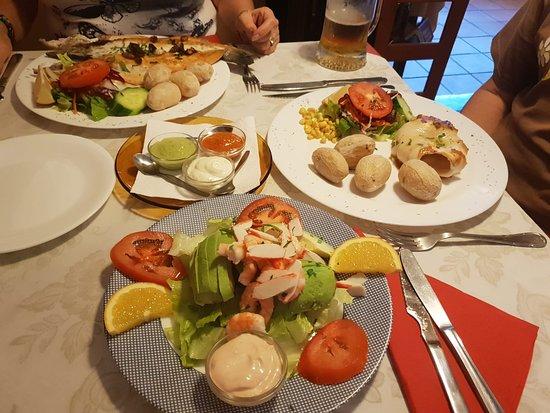 Fillet of fish (back), grilled calamari (right) and prawn & avocado salad (front).