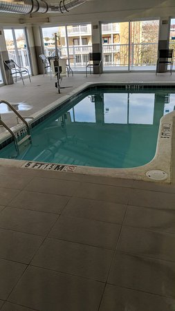 Small indoor pool in covered lanai type area