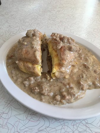 Sundance, WY: Devils Tower Breakfast (sausage patty and egg on a biscuit covered with gravy
