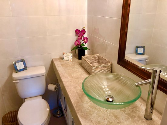 I'm the owner and I'd like to you to know that many of the photos here are outdated, since we have remodeled the Lower Level and have replaced all the windows. This is our new Lower Level Bathroom. So pretty! Wish I could delete old photos.....