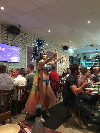 strategically placed rainbow bustle - what fun got the crown going and invited dinner sup to dance with her