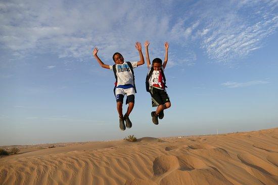 Dubai: Sunset Camel Trek & Red Dunes Safari with BBQ at Al Khayma Camp: Fun in the desert