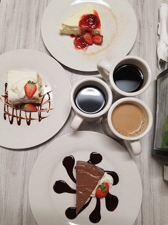 Conosur: cheese cake with berry topping, tres leche cake, and chocolate cheesecake