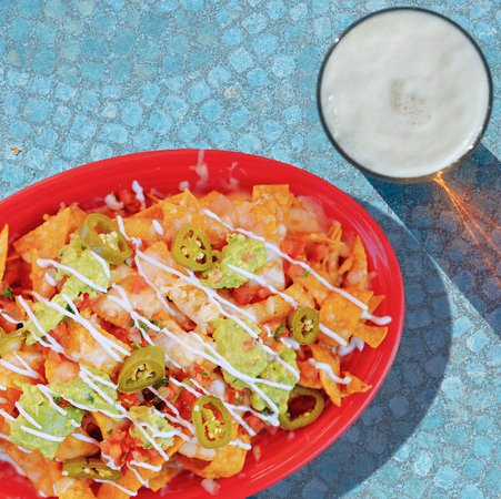 Super nachos are great for sharing (or not!) and are a local favorite.