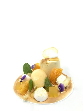 Lime cheesecake, shortbread, citrus textures, torched meringue, banana passionfruit sorbet