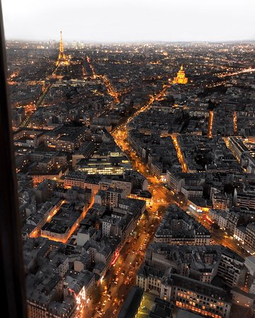Window view from Montparnasse Observation Deck (56th floor) showing the Paris, the city of lights. You can spot the Eiffel Tower and les invalides.