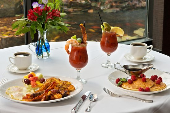 Breakfast in the glass-walled, sunlit Conservatory