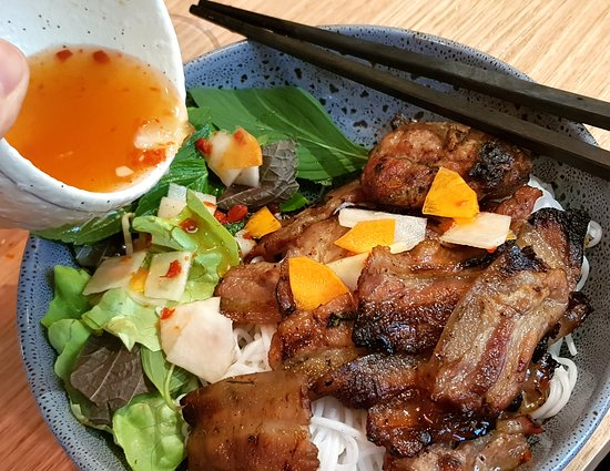 Bun cha - grilled pork on vermicelli with nuoc mam and pickles. A must try!