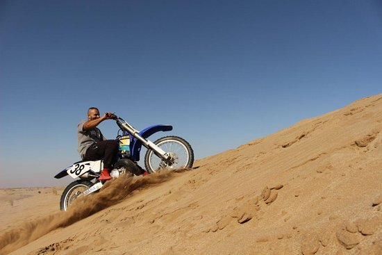 RIGH SHAGH (ریق شق) is a sand dune where dirt biking is liked and favored by many.if you are by any chance a desert kind of guy,you are in the right place.half an hour from natanz and an hour drive from kashan .this picture features me riding my Yamaha YZ 250CC Bike  shoot me on Whatsapp at 0098 913 364 9985