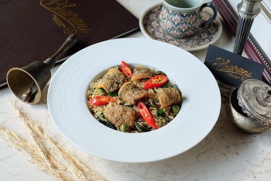 Bharani Restaurant: Green Curry Fried Rice Served with Crispy Gourami Fish