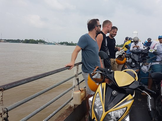 Taking the local ferry to others side of Mekong River
