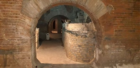 View through an archway of cellars built by monks in the 1800's (while building the monks discovered the Roman tanks and decided to use one of the areas).