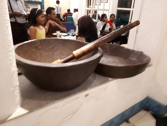 Bombay Brasserie: POT AND STIRRER WITH DINERS IN THE BACKGROUND
