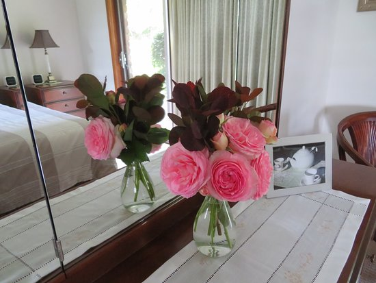 Fresh roses in bedroom of Winter suite