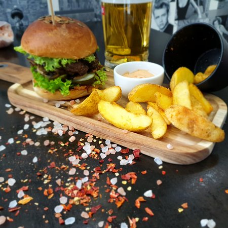 Exceptional burgers served with potatoes wedges, mayonnaise sauce with garlic fits with a cold beer.