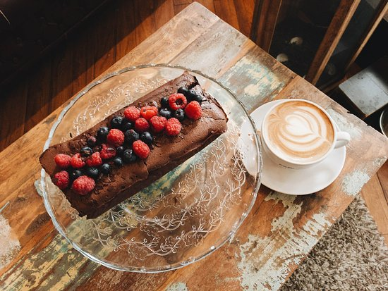 Homemade chocolate cake with fresh seasonal fruit. Served with a delicious fair trade cappuccino.