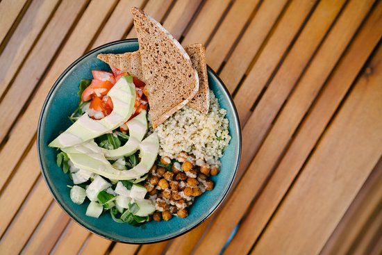 The Vegan Bowl. Chickpeas, quinoa, avocado, rocket, tomato and cucumber topped with herbed yogurt or honey mustard dressing.
