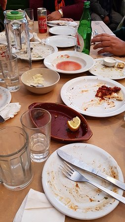 I know, I know. The plates and the drink glasses are all empty, but that is exactly how they should be after a visit to Sta Perix, at Akamatra, Ikaria!