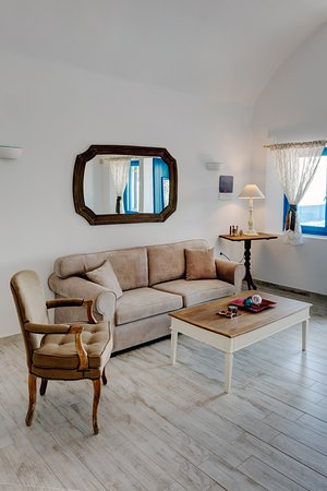 "Desiterra Luxury Suites & Villas: Luxurious Lounge area, one bedroom Suite  ""en suite"" terrace and pool. Fully Autonomous and bio climatic villas, Minimal design with traditional twists."