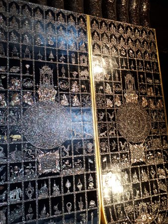 Buddha's sole. We can see very intricate inlaid design.