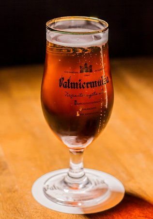 Valmiermuižas beer is only one of many different beer types at Queens Pub!!  Fact: The name of Valmiermuiža has been etched into the annals of history since the turn of the 14th century, due to the existence of an impressive tavern that belonged to Valmiera Castle, where patrons could buy beer brewed by the Lord of the Manor. Originally, Valmiera Manor was located near Valmiera Castle, but around the year 1624 it was moved to the location where Valmiermuiža Brewery is currently based.