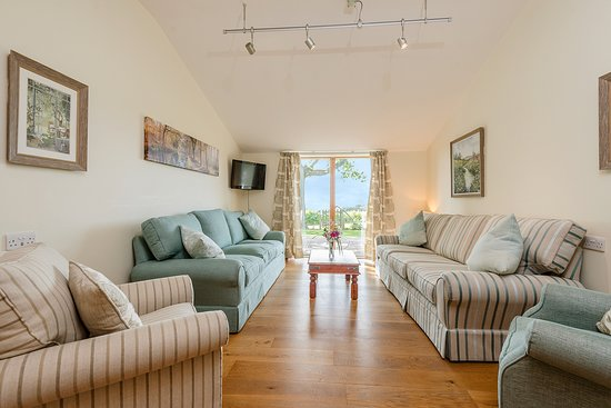 Living room area at Hedgehunter Cottage is very large and has new Laura Ashley