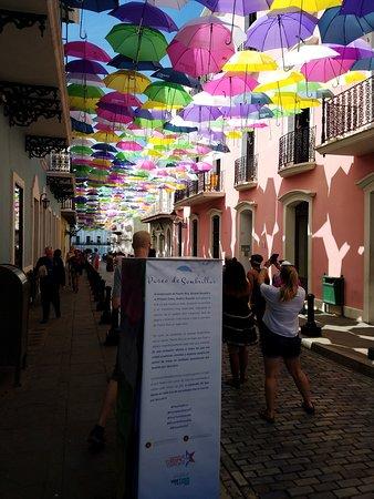 Umbrella art installation leading to the Fortaleza Building.